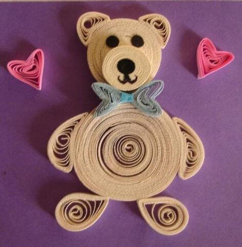 Готовая поделка с изображением квиллинг медведя
