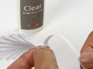 Изготовление простого бумажного ангела в стиле технике квиллинга