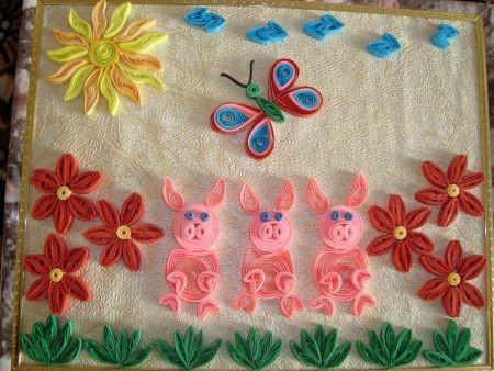 Готовая квиллинг поделка с изображением свинок