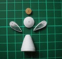Объёмный бумажный ангел в стиле технике квиллинга
