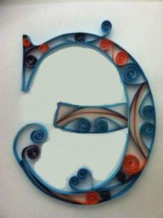Объёмная бумажная буква Э Русского алфавита в стиле квиллинга