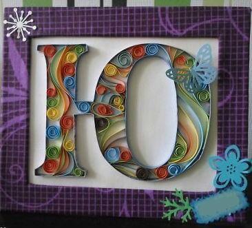 Объёмная бумажная буква Ю Русского алфавита в стиле квиллинга