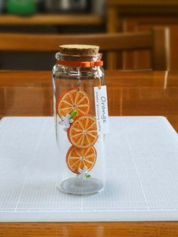Баночка с апельсином в технике квиллинг