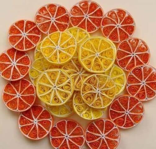 Панно с апельсином в технике квиллинг